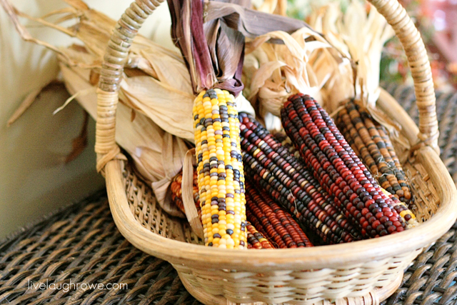 Something as simple as placing Indian Corn in large flat basket is beautiful.  Fall Decor with livelaughrowe.com