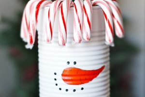 Adorable DIY Snowman using a soup can! Great winter craft activity for the kiddos. livelaughrowe.com