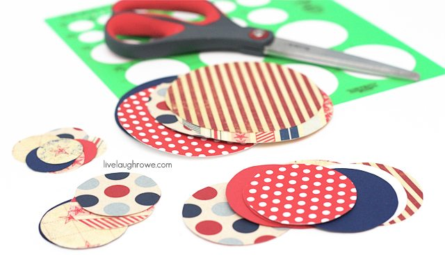 cutting the circles for patriotic paper flowers