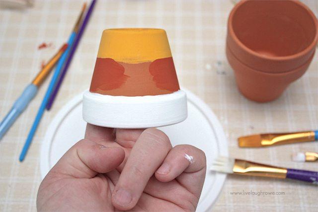 DIY Painted Candy Corn Pots.