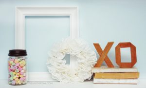Sweet Valentine Vignette with a paper doily wreath. Absolutely darling! livelaughrowe.com