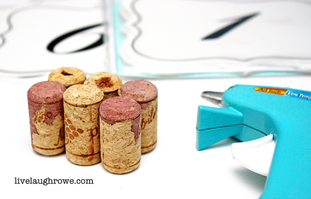 Clever! Glue corks together to make place card holders for your wedding -- or next event! livelaughrowe.com