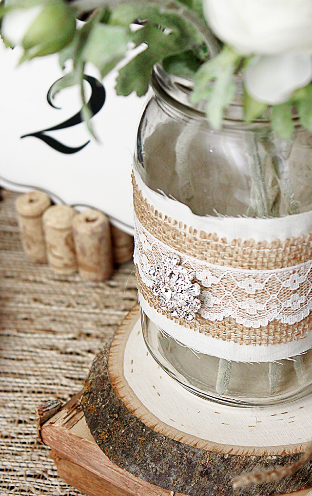 Loving these rustic jar wraps for a vintage wedding tablescape. Everything looks more rustic with a little burlap, right? livelaughrowe.com