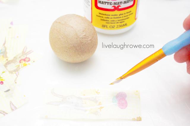brush mod podge on tissue paper