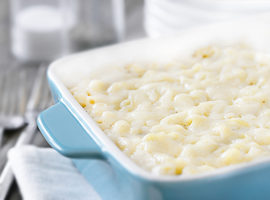 Dinner is served! This Baked Macaroni and Cheese is dangerously good. Delicious and simple -- your whole family will be begging for more. Recipe at livelaughrowe.com #dinner #macandcheese