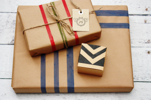 Create your own wrapping paper with painter's tape and kraft paper.  Tutorial at livelaughrowe.com