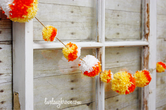 DIY Candy Corn Pom Pom Garland with livelaughrowe.com