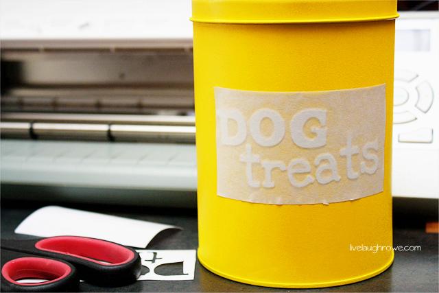 Applying dog treats vinyl to spray painted tin