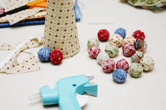 attaching scrap fabric wrapped styrofoam balls