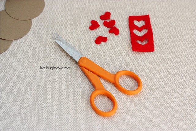 Cutting little felt hearts to attach to kraft tags