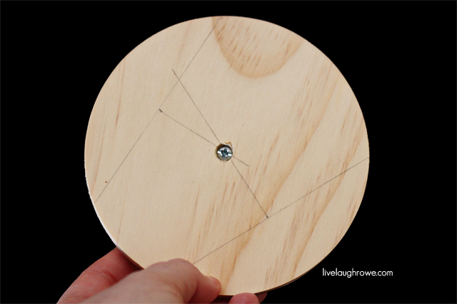 find the center of the circle, use counter sink bit to drill hole