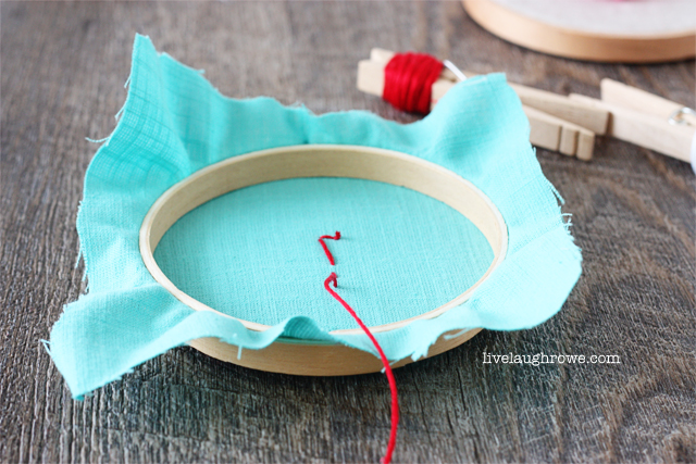 stitching on buttons as flowers for Valentine's Day hoop art