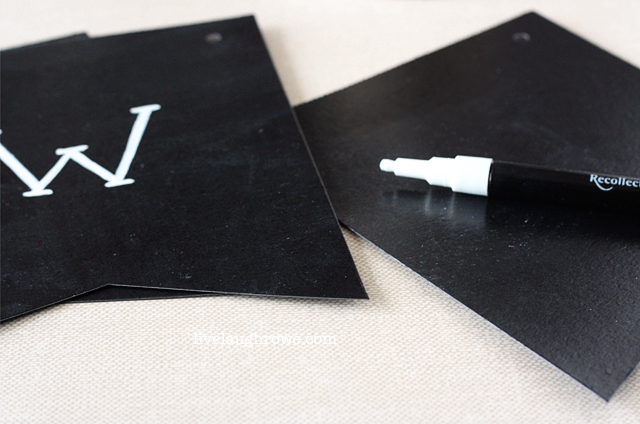use chalkboard pen to write your message onto the chalkboard pennants