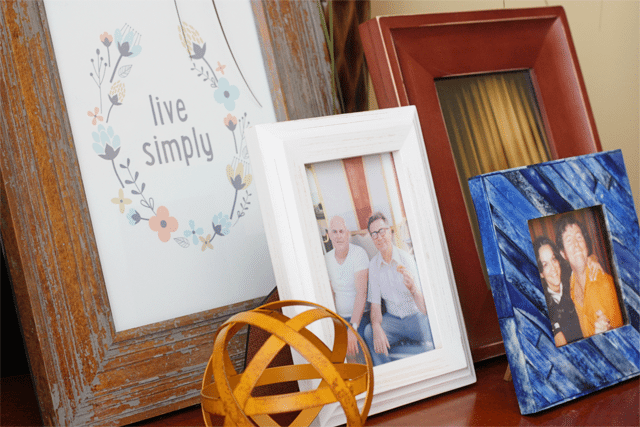 Frames with pictures of family and quotes sprinkled throughout the space