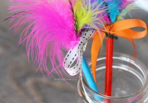 Super fun craft for the kids! Feather Topped Pencils. Tutorial at livelaughrowe.com
