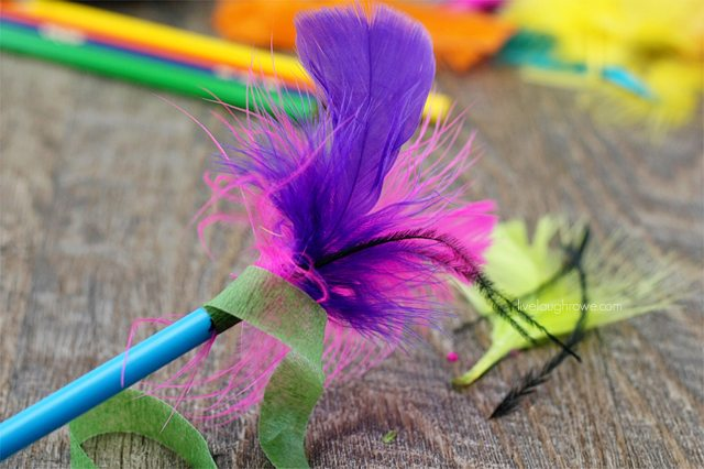 attach feathers to the pencil with floral tape