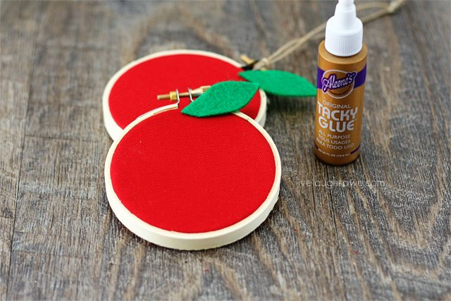 Attach leaf to Apple Hoop Art with glue.
