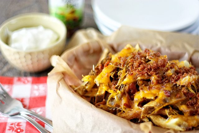 The Best Homemade Cheese Fries. My husband loves cheese fries and has perfected them. Are you ready? Recipe at livelaughrowe.com. #cheesefries