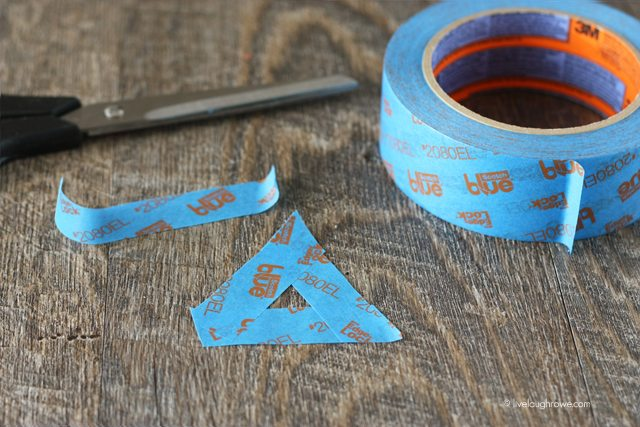 Creating small triangle stencil with ScotchBlue painters tape.