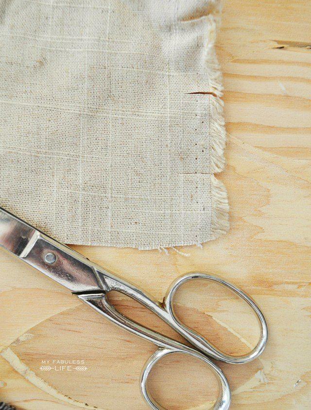 Darling Fall Rag Garland using scrap fabric and pom pom trim! Make one for yourself in minutes! Tutorial at livelaughrowe.com #fall #fallgarland