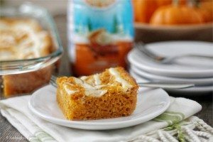 Skinny Pumpkin Cream Cheese Swirl Bars. Served warm, this recipe will have your taste buds doing a happy dance. www.livealaughrowe.com #dessert #pumpkin