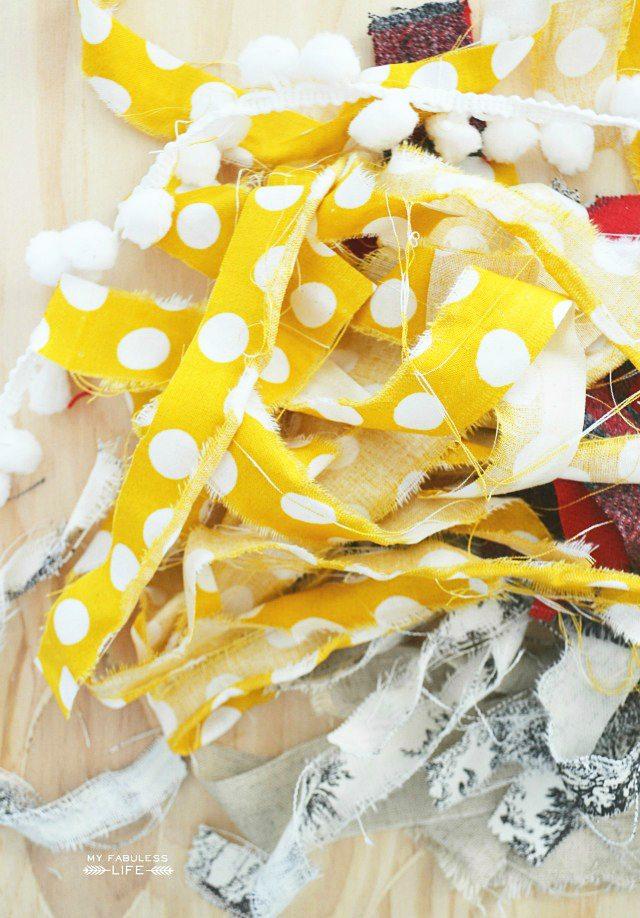 Simple Fall Rag Garland using scrap fabric and pom pom trim! Make one for yourself in minutes! Tutorial at livelaughrowe.com #fall #fallgarland