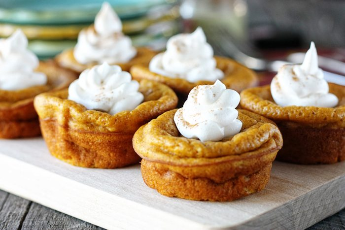 A crowd pleasing, make ahead recipe that allows for more family time during the holidays!  Impossibly Easy Mini Pumpkin Pies