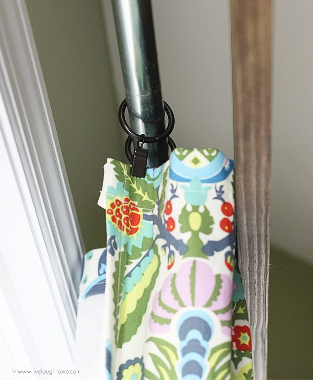 Closer look at the curtains hung with curtain clips using the attached curtain rod!  www.livelaughrowe.com