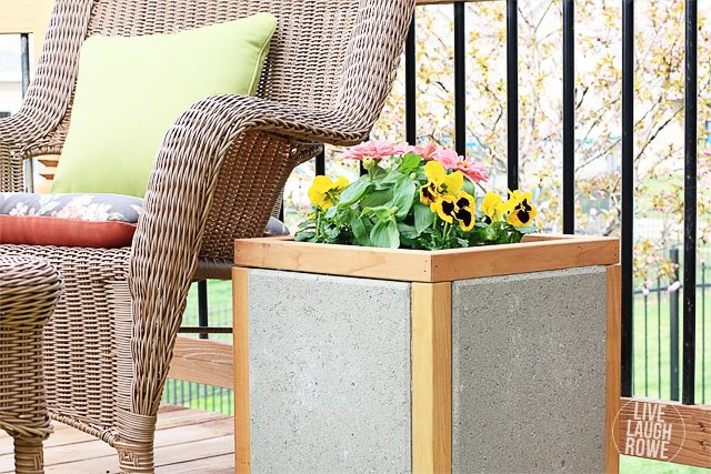 DIY Paver Planter Box. Great do-it-yourself planter box to display seasonal flowers! Tutorial at www.livelaughrowe.com #DIHWorkshop #sp