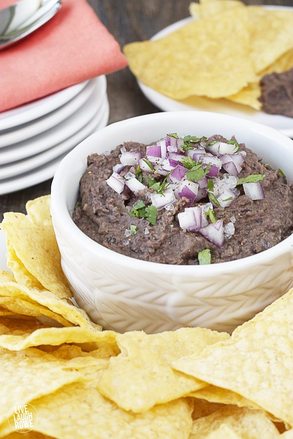 A quick Black Bean Dip that is SOOO good! Puréed goodness made of beans, onion, vinegar, orange juice, cilantro, oil, garlic and cumin. Recipe at livelaughrowe.com