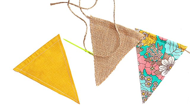 Stringing the double sided pennant banner onto twine with yarn needle. livelaughrowe.com