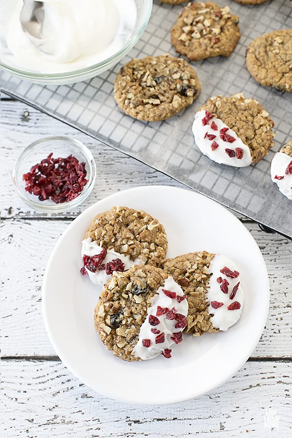 Delicious and EASY Cookies. White Chocolate Dipped Oatmeal Raisin Cookies. Recipe at livelaughrowe.com