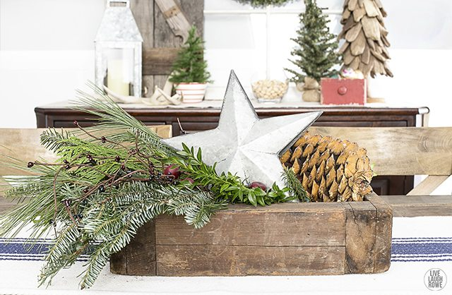 Lovely Christmas centerpiece using a vingtage box, greenery and a galvanized star. livelaughrowe.com