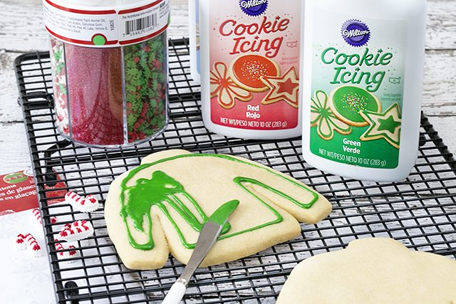 Spreading the icing on the ugly sweater christmas cookies!