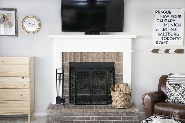 The mantel makeover has finally come to fruition -- and we didn't paint the oak! livelaughrowe.com