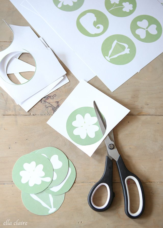 Cutting Circles for Printable St. Patrick's Day Banner.