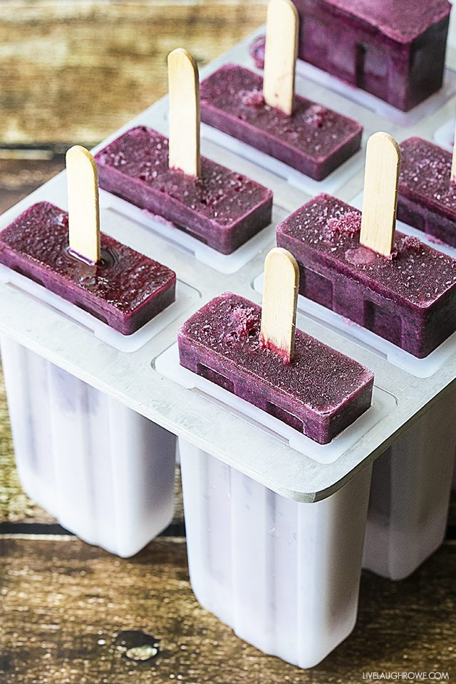 Blueberry Cheesecake Popsicles are the perfect icy treat on a stick for the blueberry lover. Fruit and dairy all in one too! livelaughrowe.com