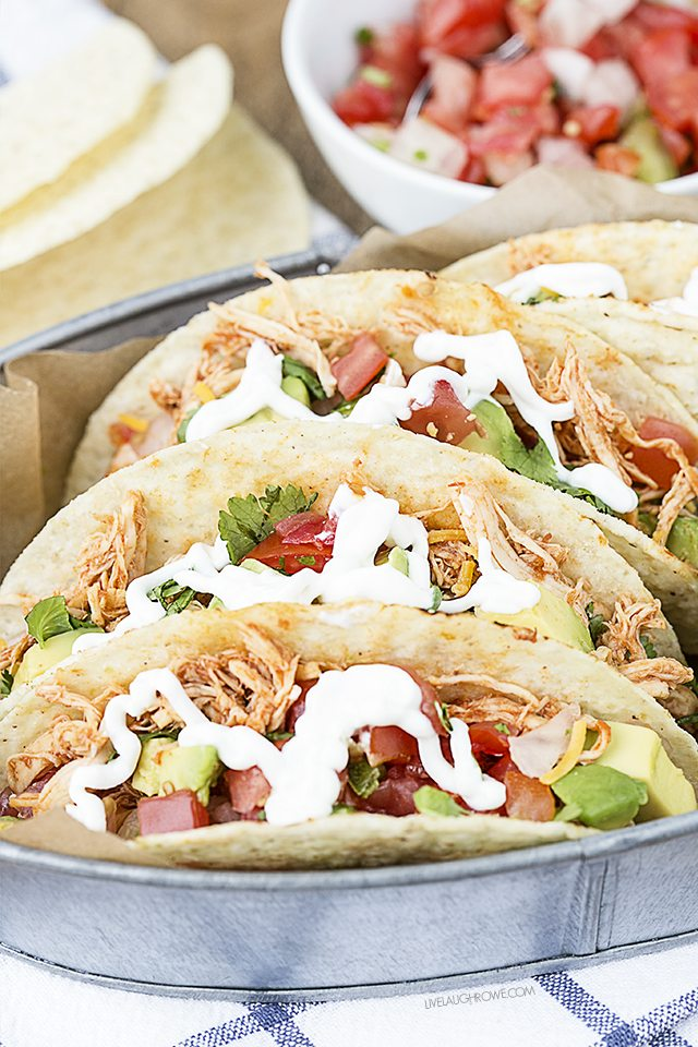 Turn ordinary chicken into flavorful tacos! These Easy Shredded Chicken Tacos are sure to be a new favorite for Taco Tuesdays. livelaughrowe.com