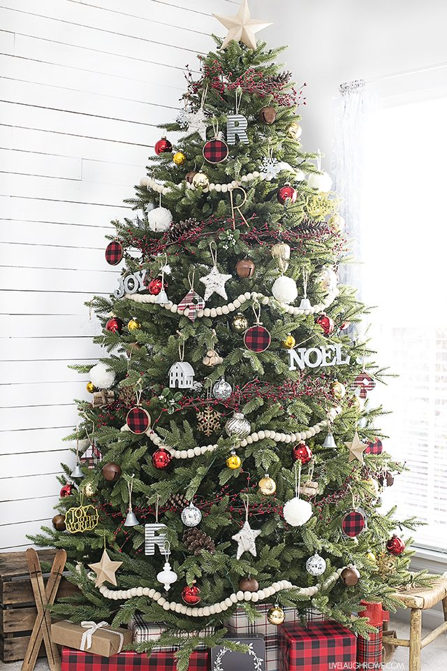 Simple rustic Christmas tree using wool felt balls for garland and splashes of plaid. Love the mix of the old and the new too. livelaughrowe.com