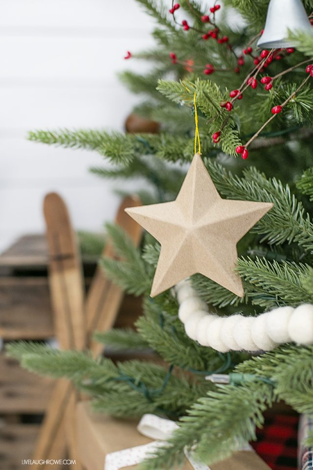 Simple rustic Christmas tree with paper mache star ornament. livelaughrowe.com