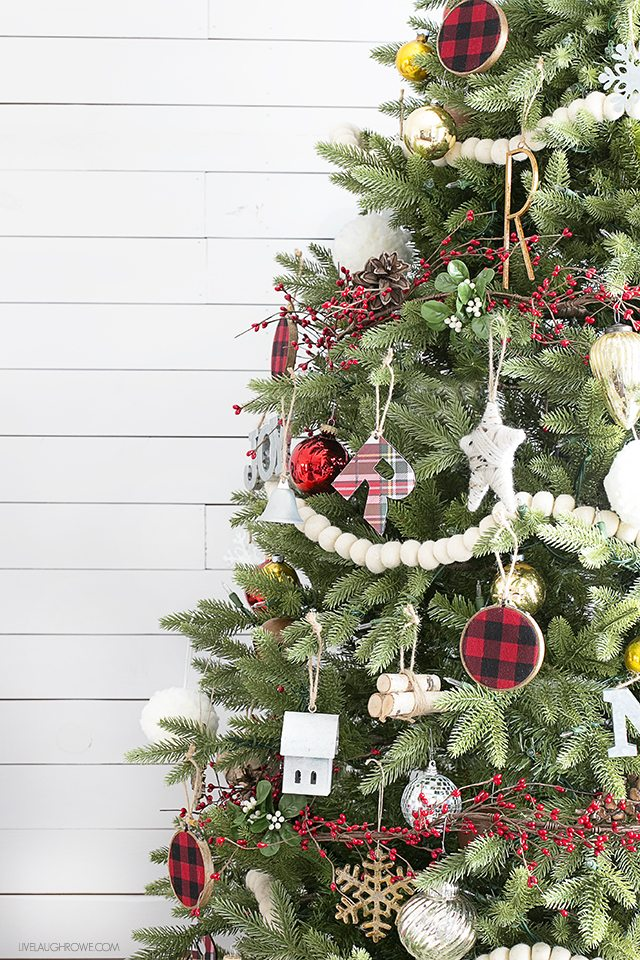 A simple rustic Christmas tree using wool felt balls for garland and splashes of plaid. Love the mix of the old and the new too. livelaughrowe.com