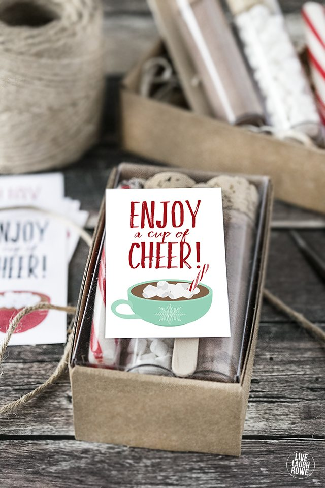 Create a Hot Chocolate gift set and use these 'Enjoy a Cup of Cheer' printable tags/stickers for packaging. LOVE THIS! livelaughrowe.com