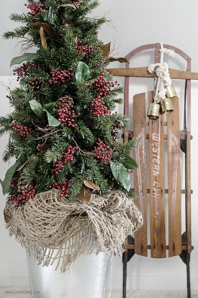 Beautiful vintage inspired Christmas Dining Room decor! Love the old sled! livelaughrowe.com ...