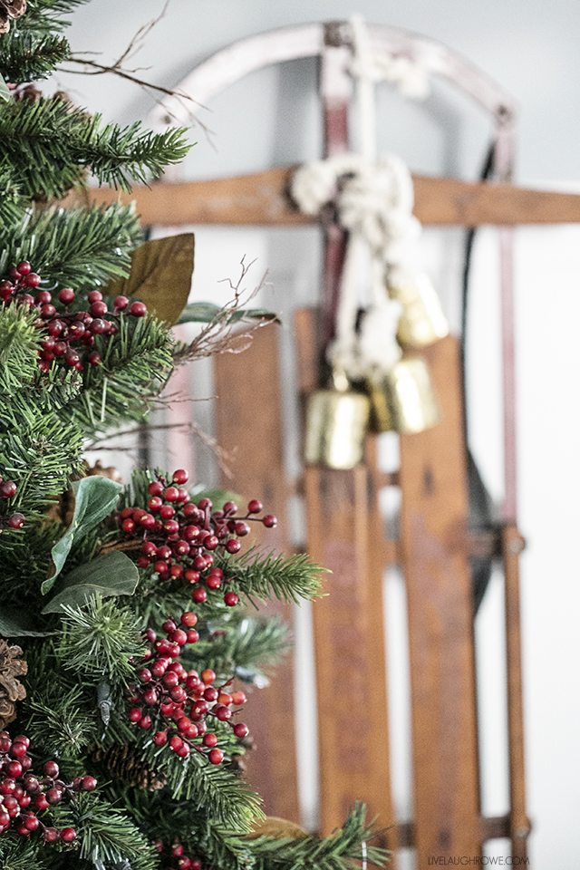 Beautiful vintage inspired Christmas Dining Room decor! Love the old sled! livelaughrowe.com