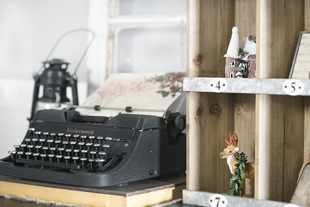 Beautiful vintage inspired Christmas Dining Room decor! That old typewriter, sled and the wreath of vintage Christmas cards are perfect! livelaughrowe.com