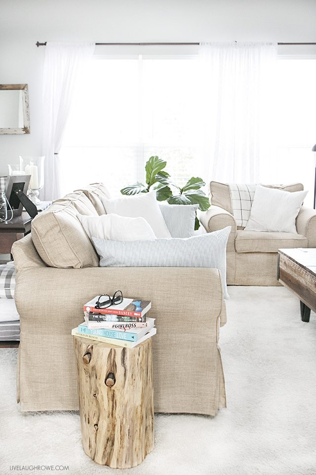 Custom slipcover that is durable, washable and pet friendly! They add a warmth to this cozy space as well. livelaughrowe.com