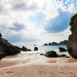 Planning some upcoming travel? These are seven of the best ways to save money for and on your trip. livelaughrowe.com (Photo: Horseshoe Bay in Bermuda)
