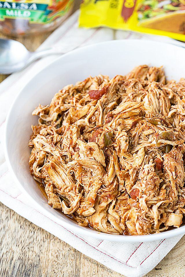 This Slow Cooker Salsa Chicken is not only easy to make, it's delicious on salads, sandwiches, tacos, wraps and more. Recipe at livelaughrowe.com