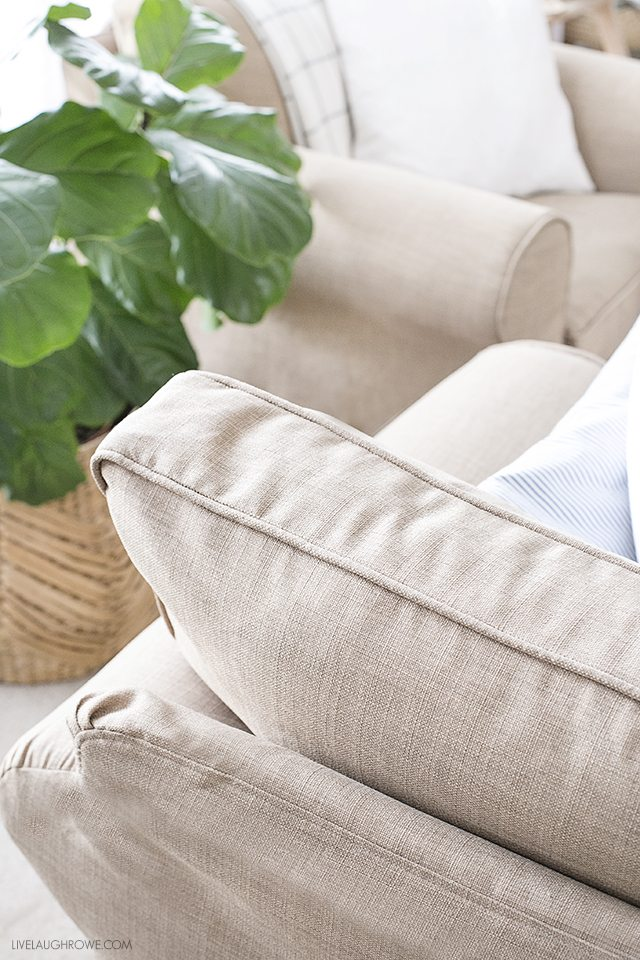 Custom slipcovers that are durable, washable and pet friendly! They add a warmth to this cozy space as well. livelaughrowe.com