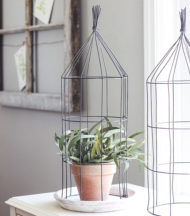 A Touch of Farmhouse Charm. Easy DIY Projects to Add a Warm and Rustic Fell to Any Room. This wire cloche is one of the lovely projects found in the book. livelaughrowe.com